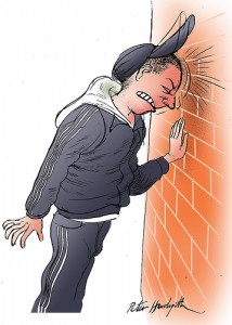Head against a brick wall