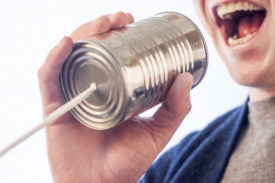 basic forms of communication - the early telephone tin can
