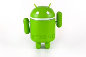 """Herne, Germany - March 8th 2012: Google Android mascot shot on white, frontal view, greeting."""