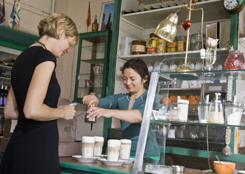 Female barista helping a female customer --- Image by © Andersen Ross/cultura/Corbis